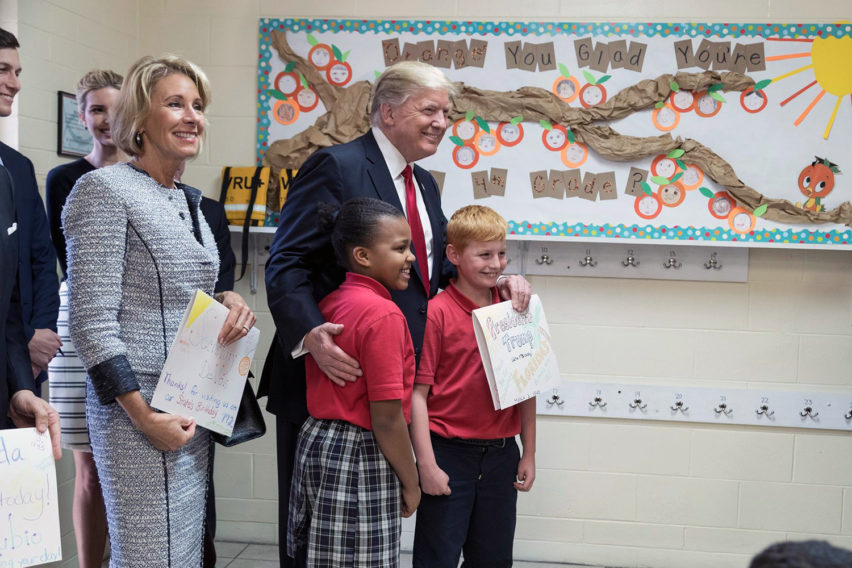 Betsy_DeVos_and_Donald_Trump_with_students,_March_2017