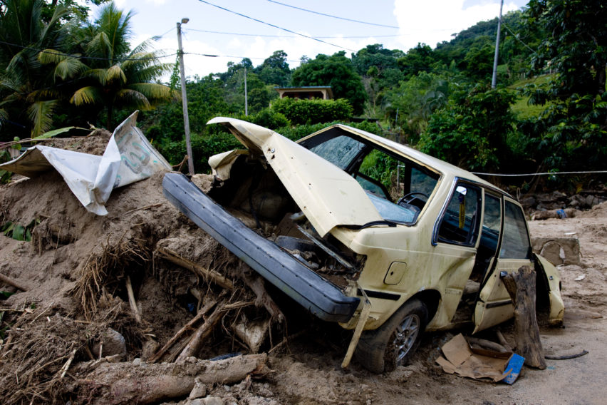 September 28, 2008, Manuabo, Puerto Rico--Destroyed vehicle and road damage on Route 759 following recent flooding. Andrea Booher/FEMA