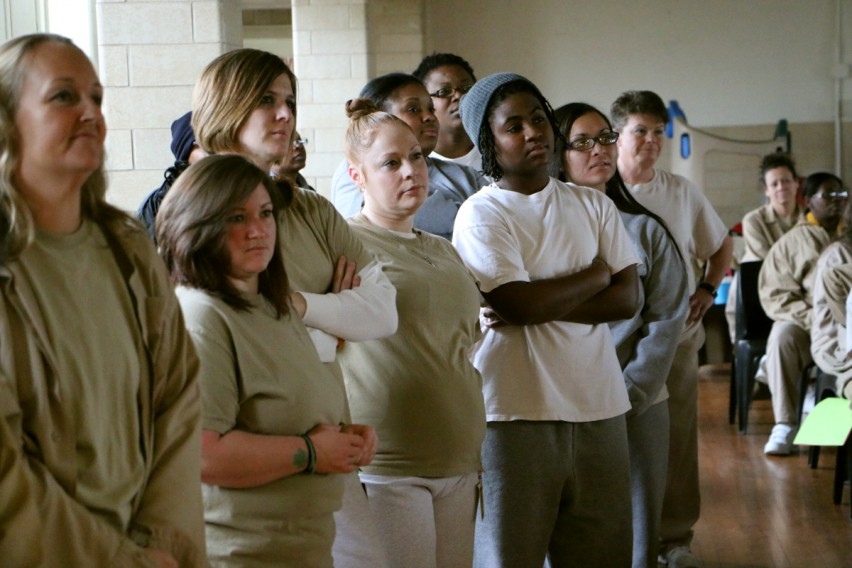 Leah Moss AKA Red stood amongst fellow inmates at the talent show in Indiana Women's Prison.